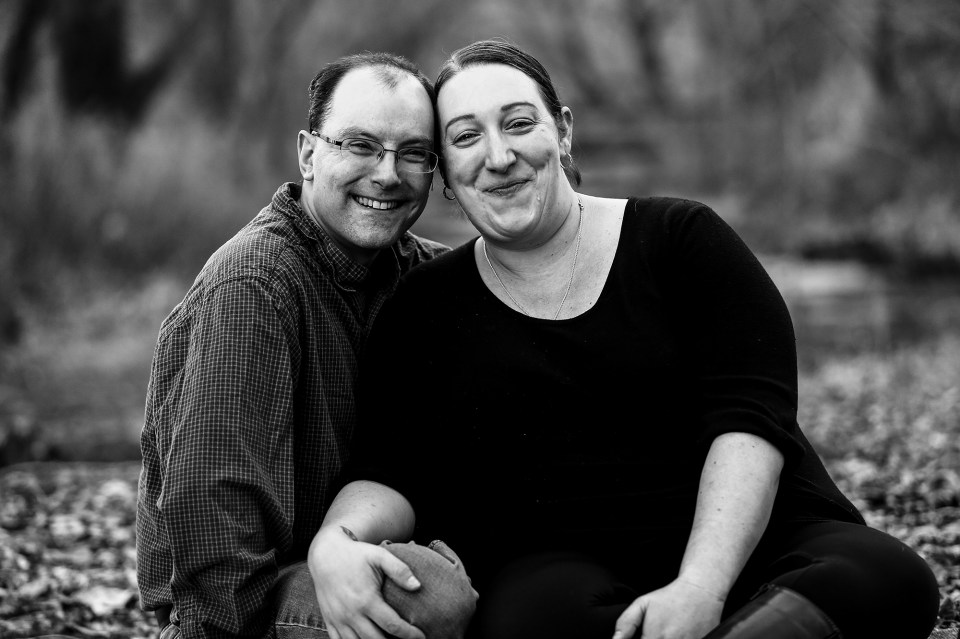 Couple poses together during Frontier Park family portraits session