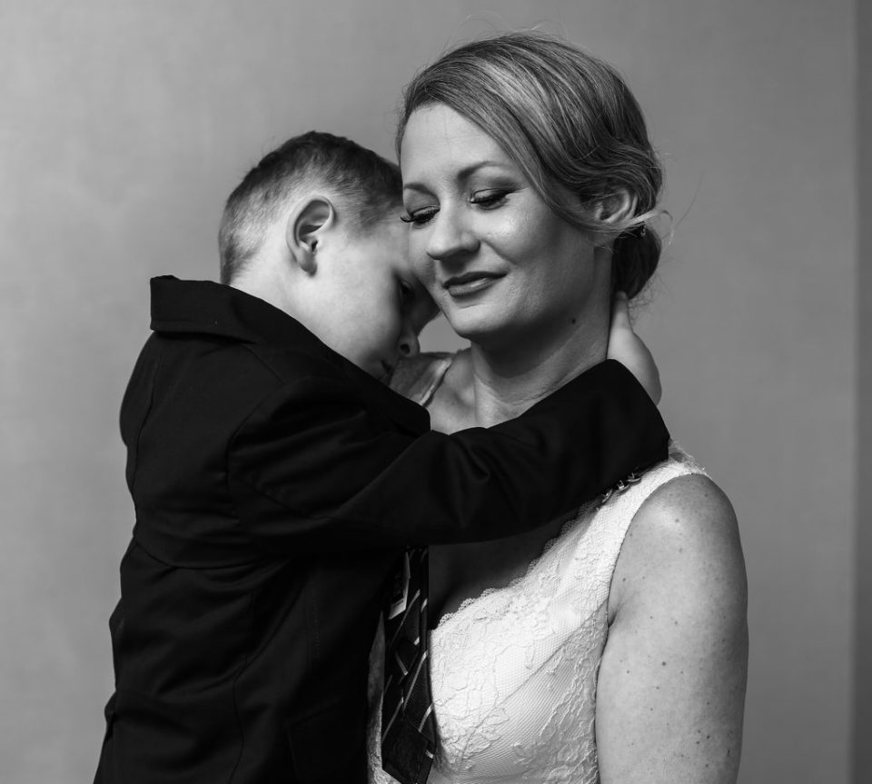 Bride embraces her son, the ringbearer