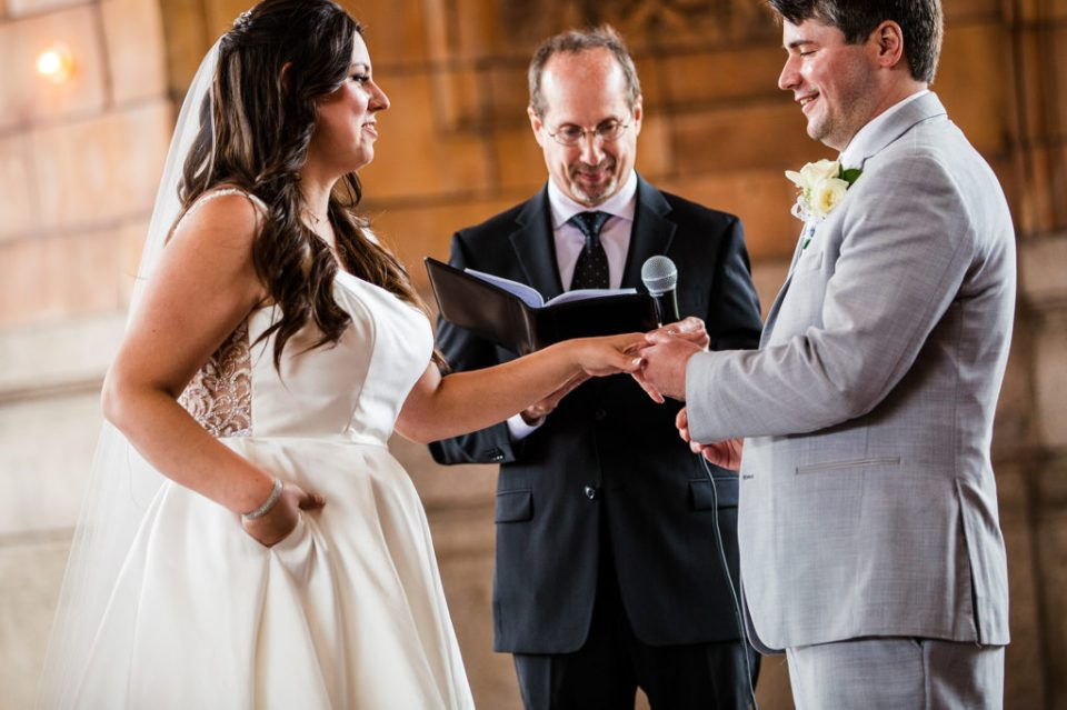 Couple exchanges vows during Pittsburgh wedding at Rotunda of Pennsylvanian Apartments