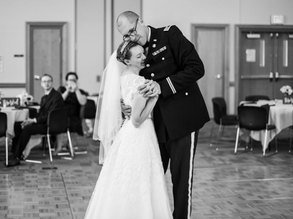 Bride and groom share first dance during their wedding at Edinboro University
