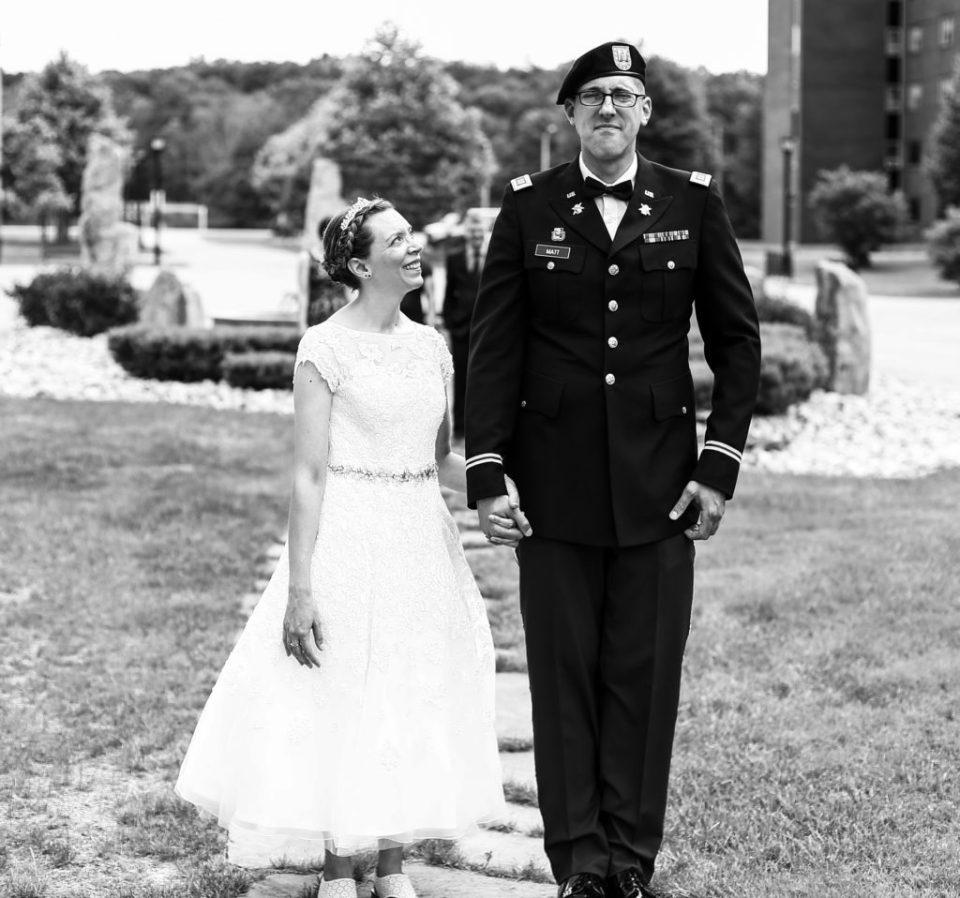 Bride looks at groom lovingly during wedding at Edinboro University
