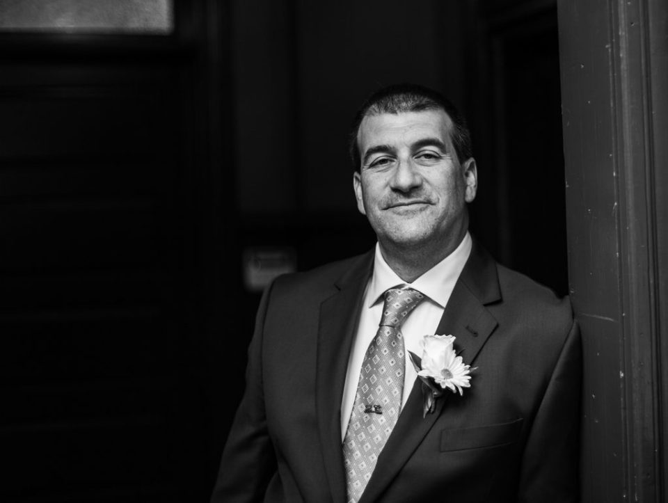 Solo portrait of groom before wedding at the Schoolhouse