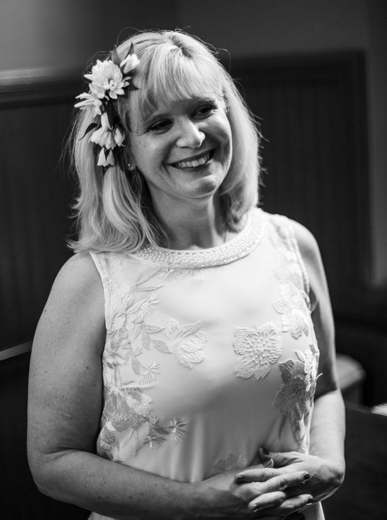 bride smiles at the camera before her wedding at the Schoolhouse