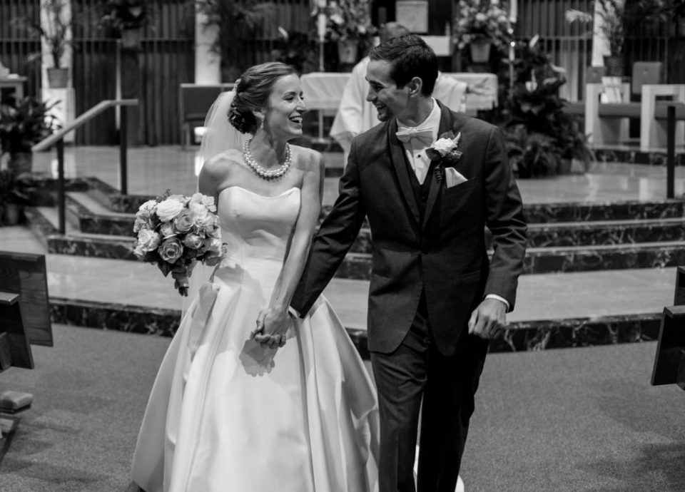 Recessional portrait of bride and groom after their wedding at St.Jude Church in Erie, PA