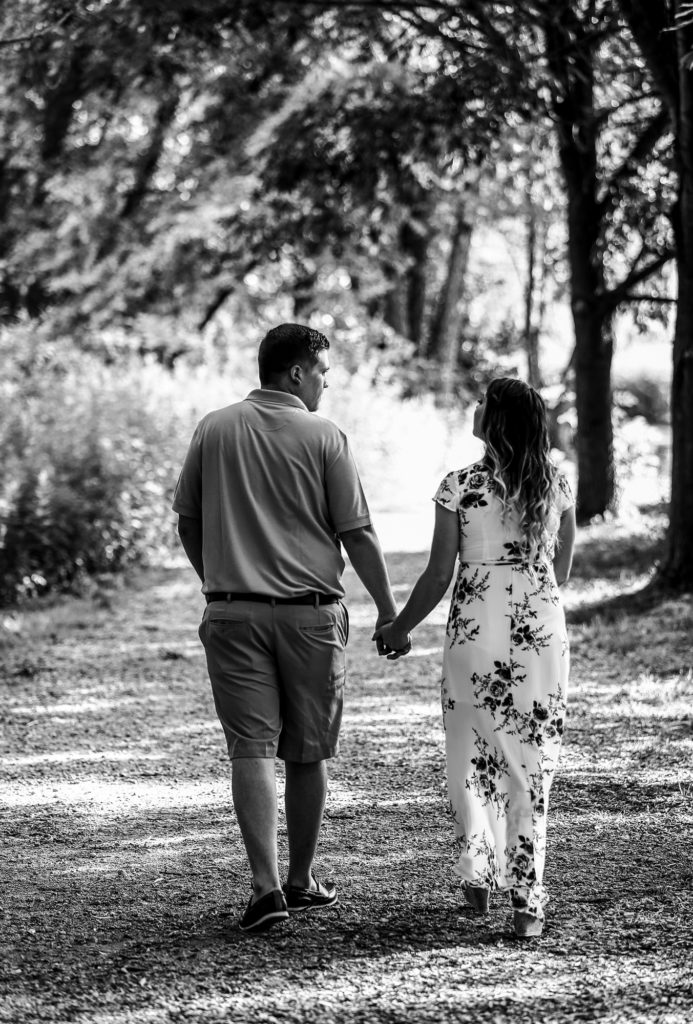 Couple walking a path at Frontier Park in Erie, PA