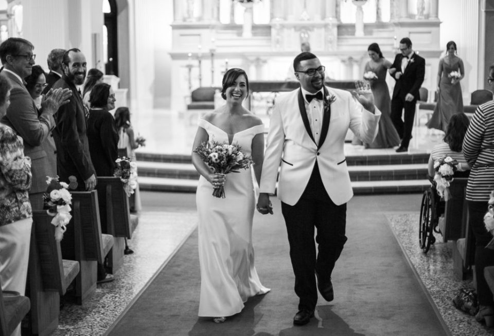 Couple walking down the aisle at the end of their St. Patrick's church wedding