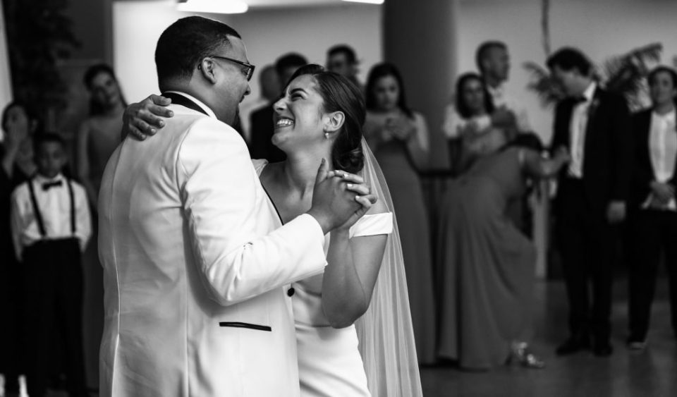 bride and groom laughing together at their Boston Store wedding