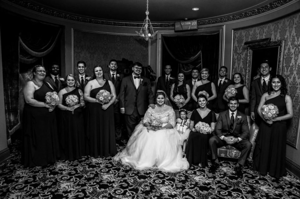 Portrait of bridal party at a summer Warner Theatre wedding
