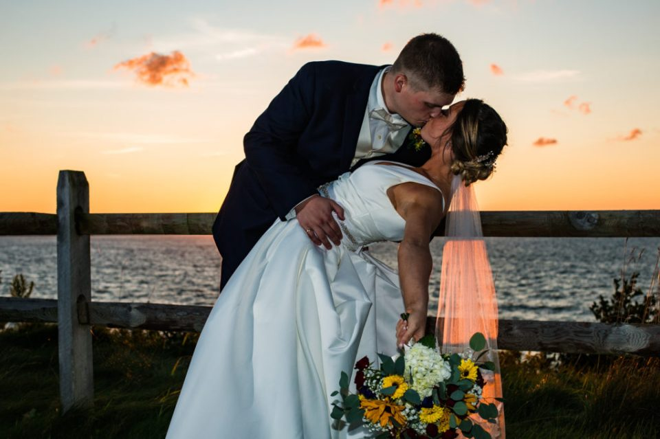 Bride and groom kissing outside at sunset during their Lawrence Park Golf Club wedding reception