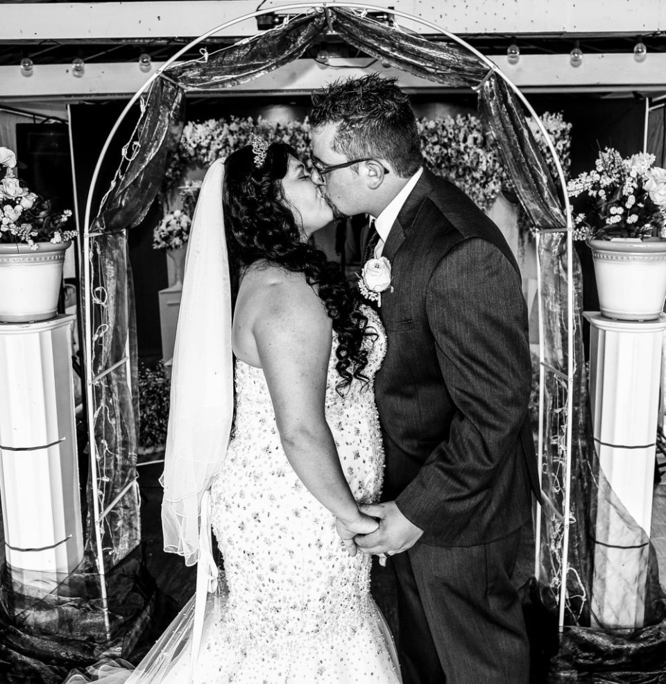 First kiss at a rustic Connellsville wedding