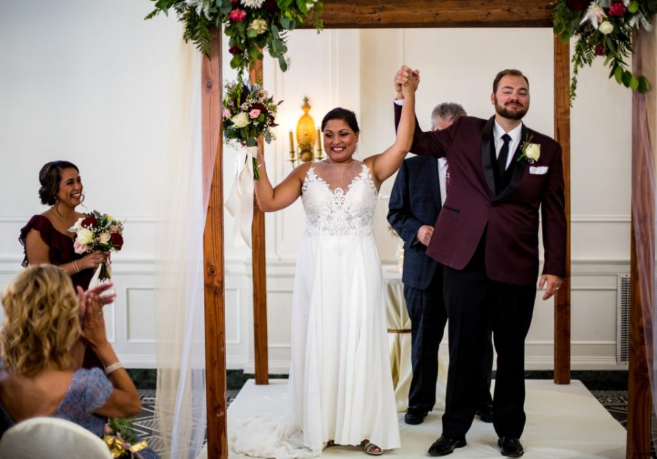 Couple celebrates marriage at the end of their George Washington Hotel wedding ceremony