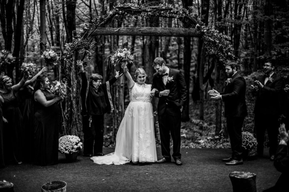Bride and groom celebrate their marriage at the end of their Majestic Woods wedding ceremony