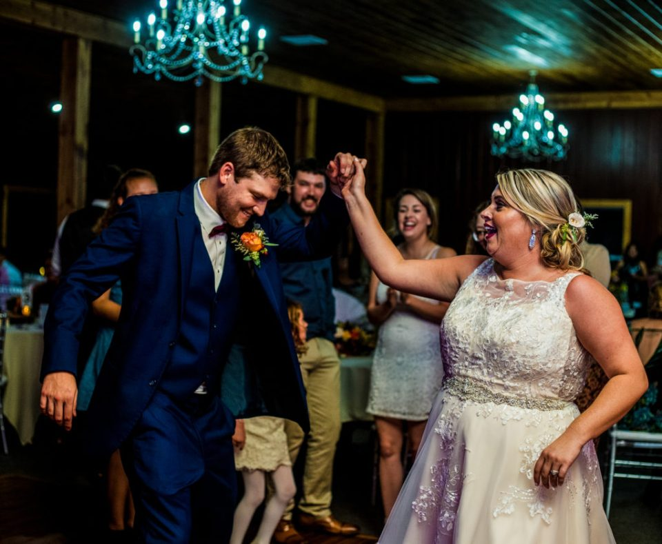 Bride and groom dancing at Majestic Woods wedding reception