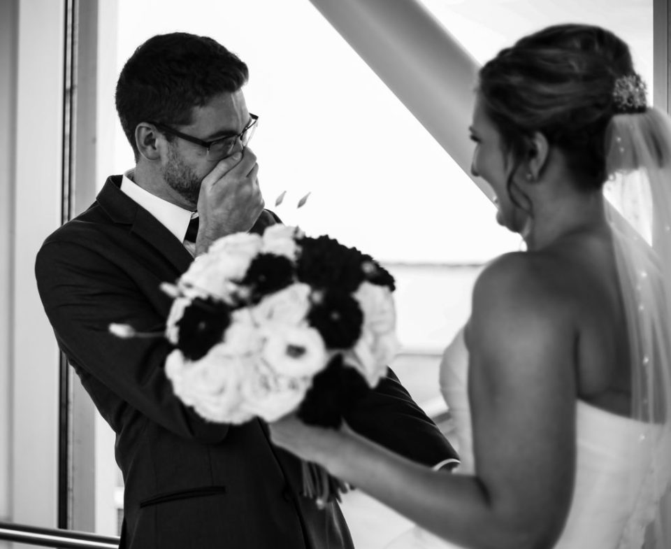 Groom reacts to seeing his bride during first look at Sheraton Erie Bayfront Hotel wedding