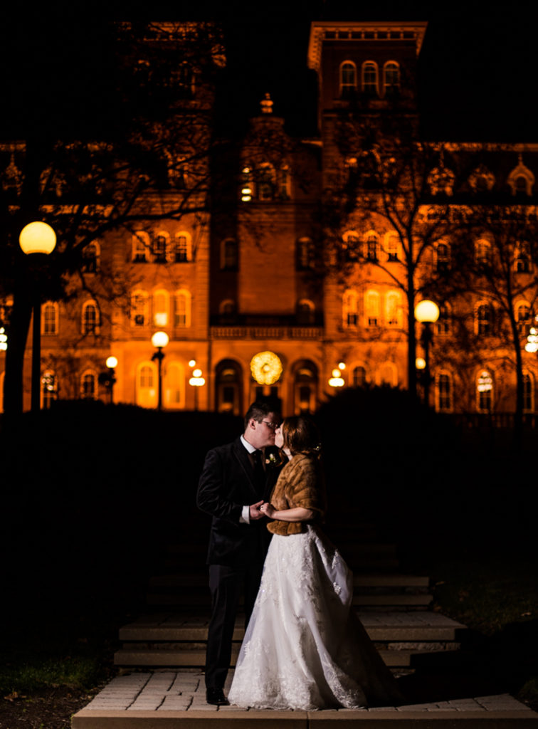 Bride and groom kiss on the Washington and Jefferson college campus at night