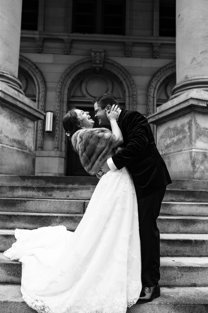 Bride and groom laughing on the steps of the Washington County Courthouse