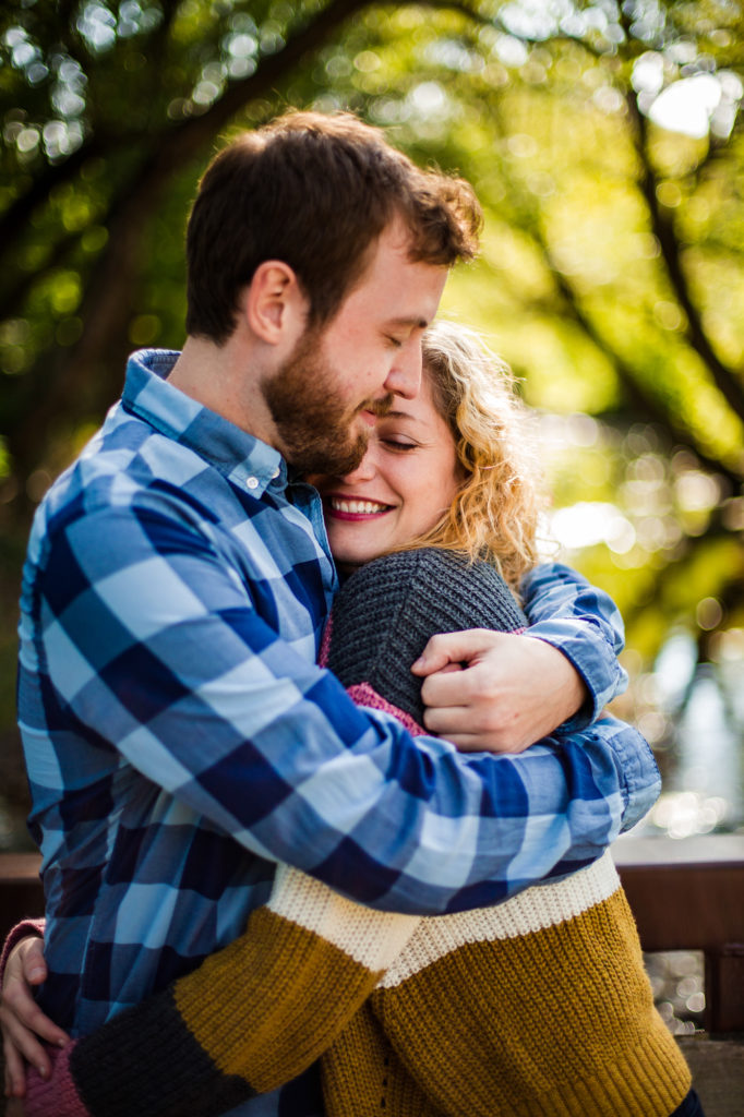 Man hugs woman for Frontier Park engagement photos