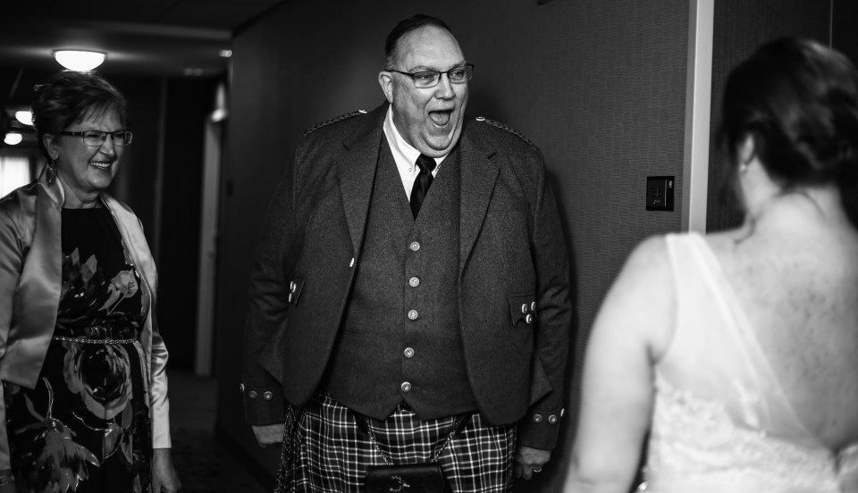 Father reacts to seeing his daughter, the bride, in her wedding dress