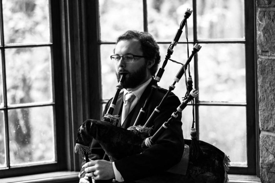 Man playing bagpipes for Scottish themed wedding at Bushy Run Battlefield