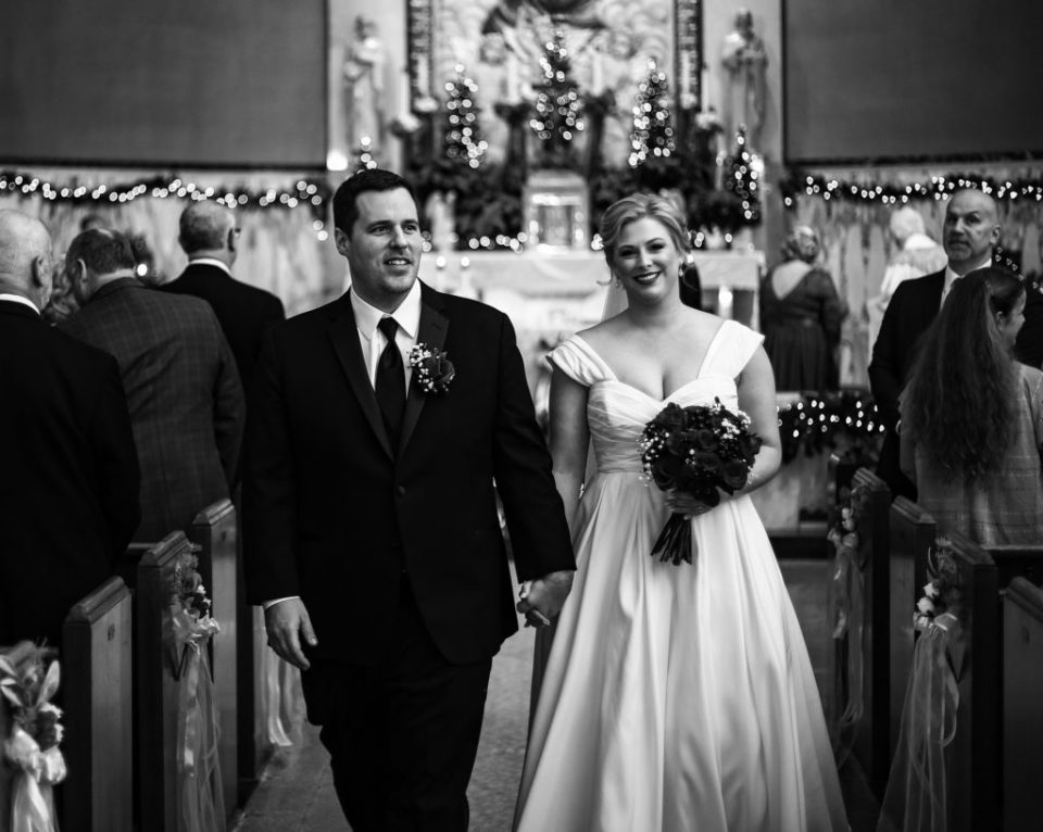 Recessional photo of bride and groom at Holy Trinity Catholic Church in Erie, PA