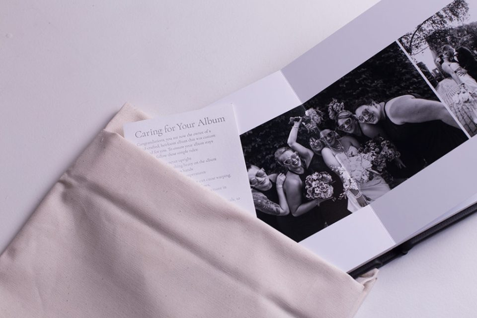 Wedding album laid opennext to canvas cover and care instructions