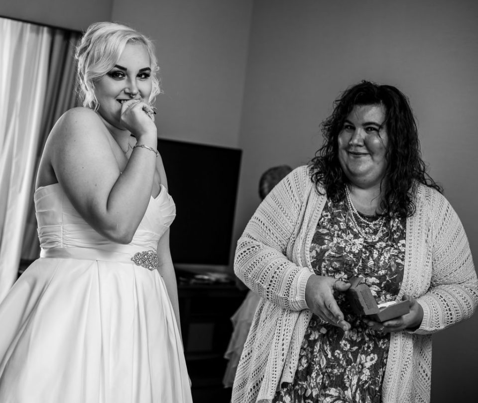 Part of wedding planning tips, bride eats chicken nuggets while getting ready