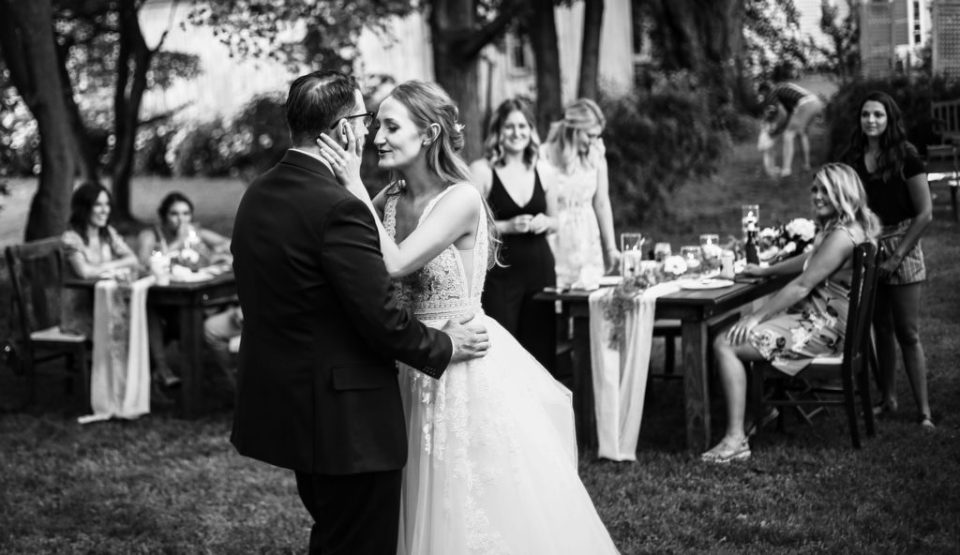 Couple shares their first dance at their intimate backyard wedding