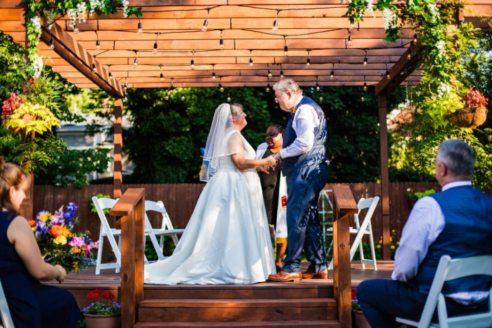 Couple exchanges vows during an intimate back garden wedding