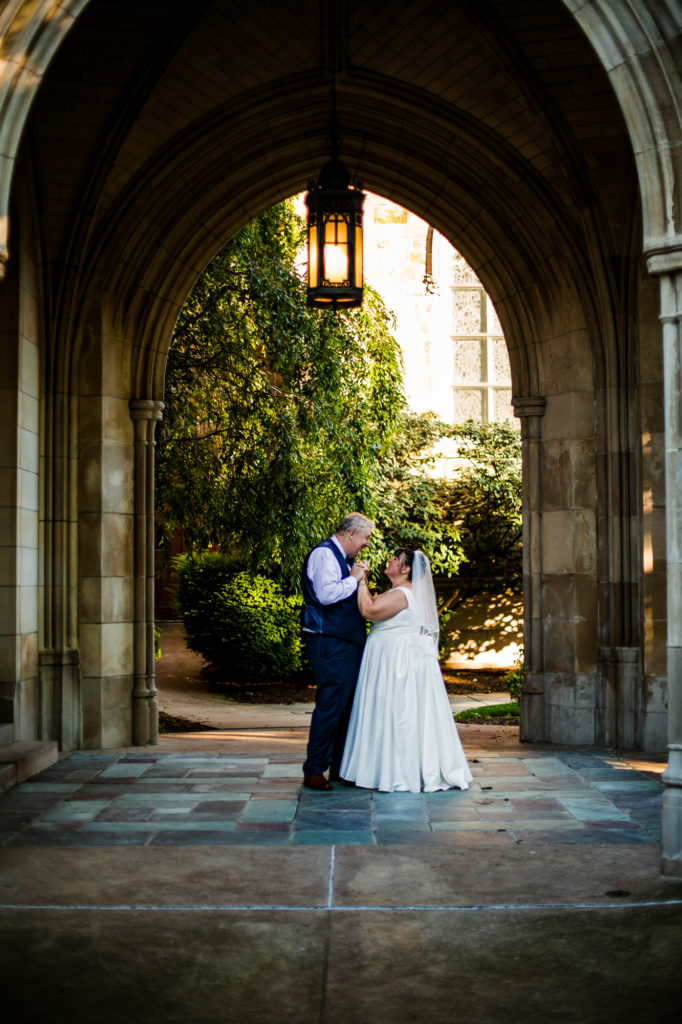 Bride and groom dance in portico of First Presbyterian Church of the Covenant in Erie, PA