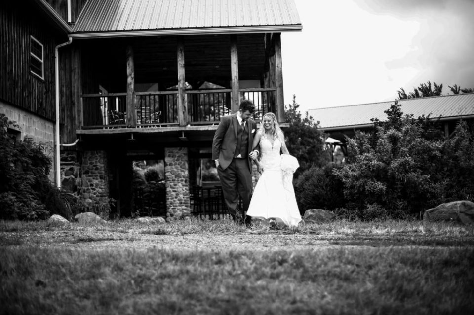 Bride and groom walking the grounds at Quincy Cellars