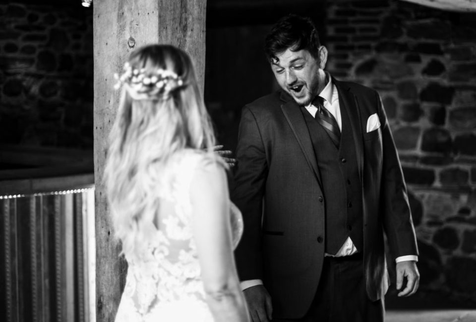 Groom's emotional reaction to seeing bride during first look portraits at Quincy Cellars
