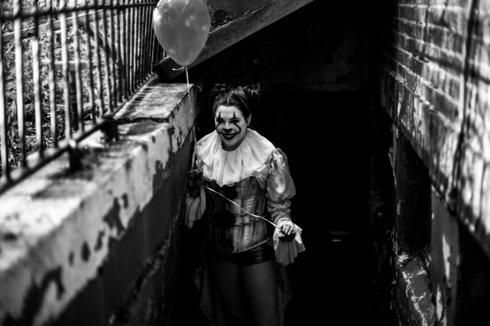 Woman dressed as Pennywise the Clown for surprise Halloween engagement photos