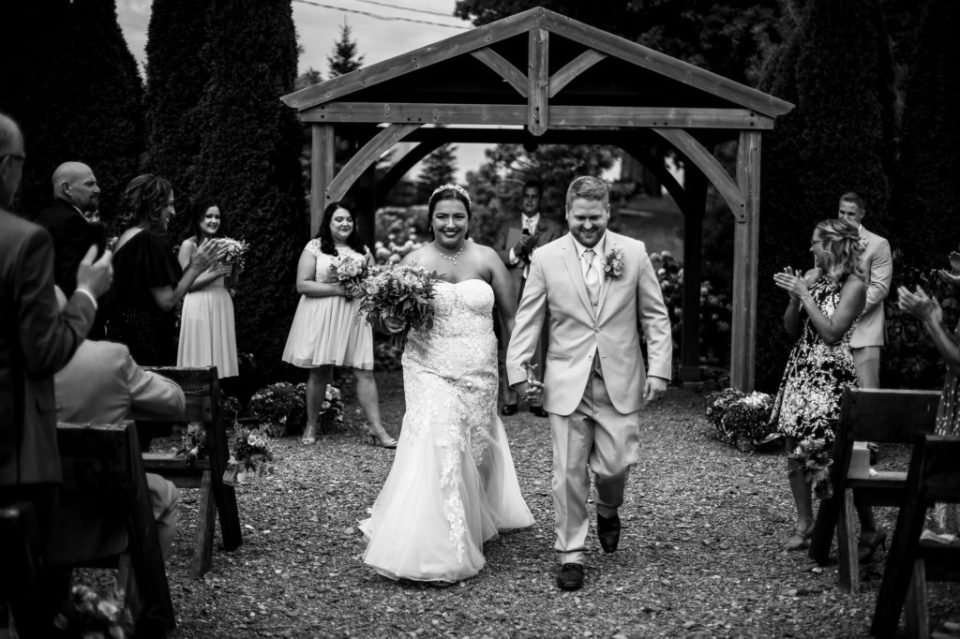 Recessional portrait of bride and groom at Port Farms wedding