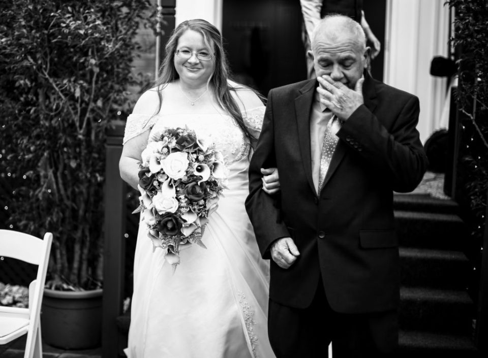 Bride escorted by her father at intimate home wedding in Erie, PA