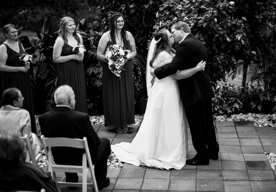 Bride and groom share first kiss at intimate wedding in Erie PA