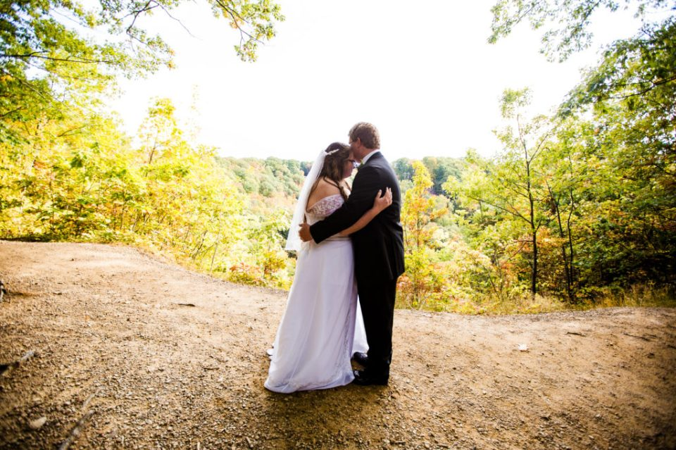 Bride and groom embrace at Wintergreen Gorge in Erie, PA