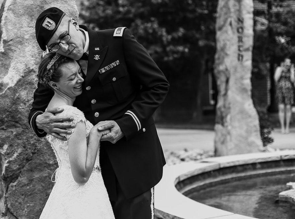 Groom hugs bride during first look photos at their Edinboro University wedding