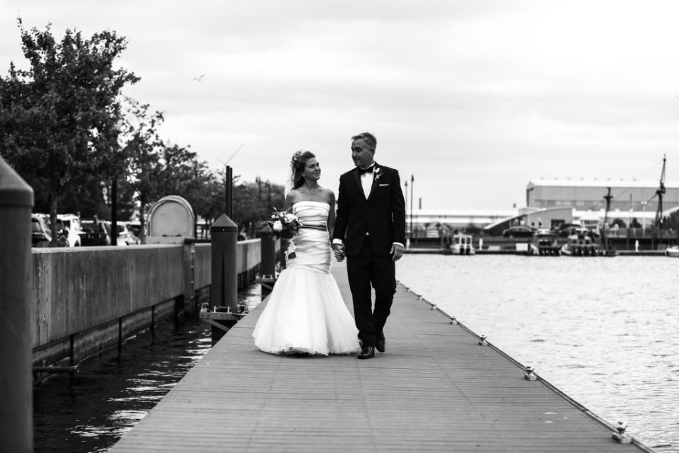 Bride and groom walk along the Bayfront in Erie, PA