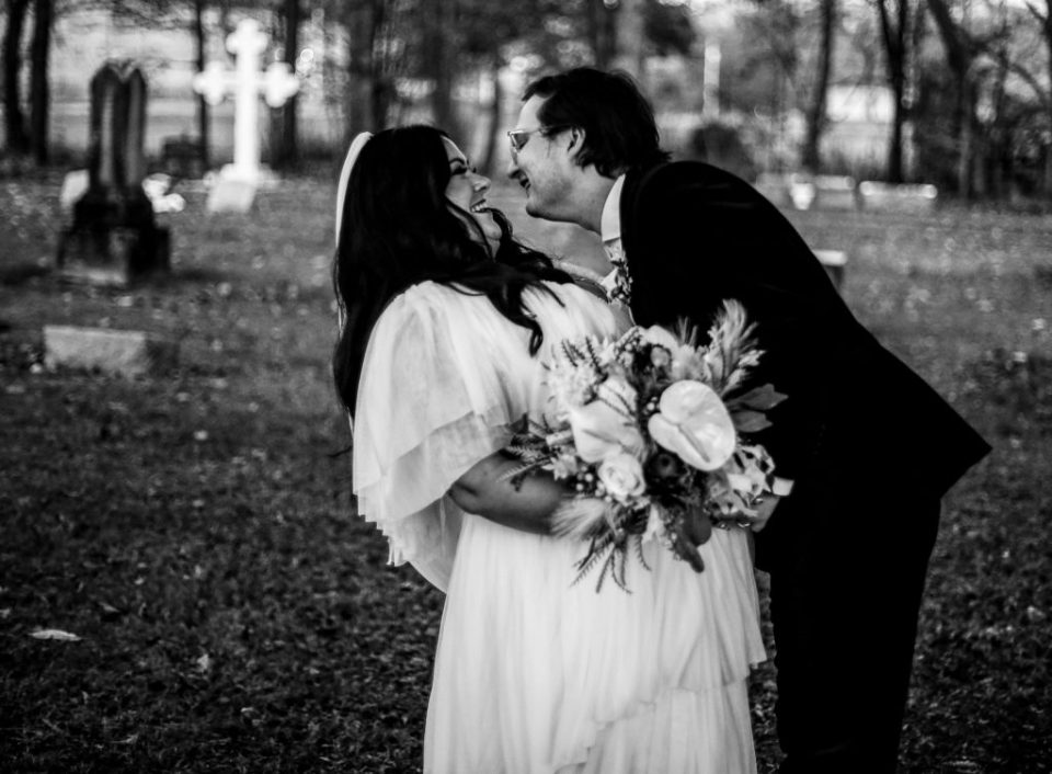 Bride and groom laughing in local cemetery in Clymer, NY