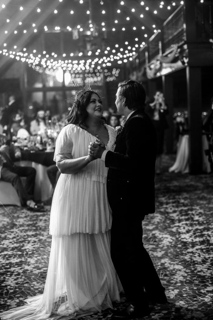 Bride and groom share first dance at Peek'n Peak wedding reception