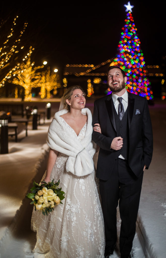 Couple admires the lights of Perry Square after their micro wedding in Erie, PA