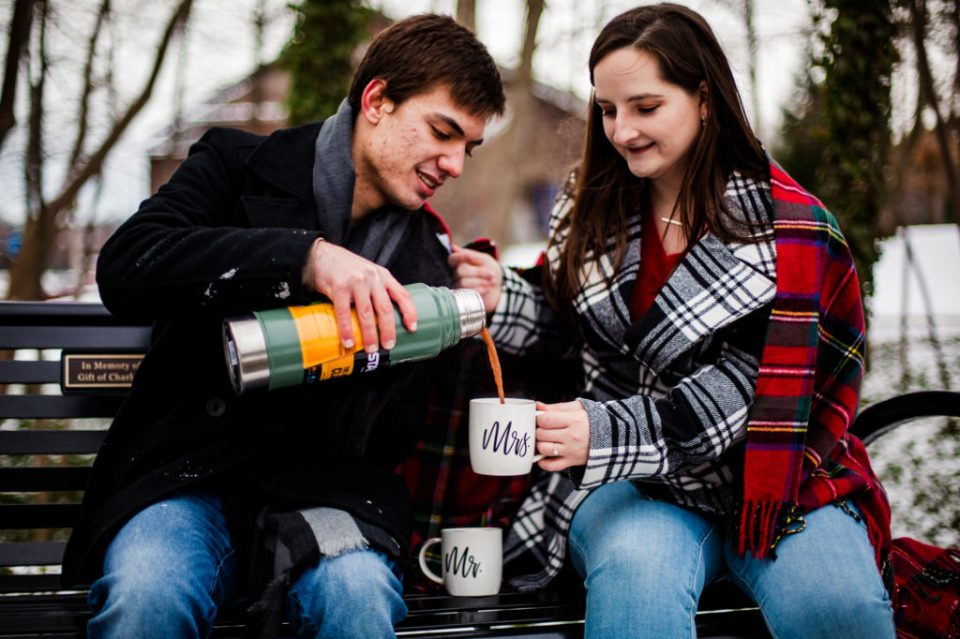 Man pours hot chocolate in mug for his fiancee at Penn State Erie