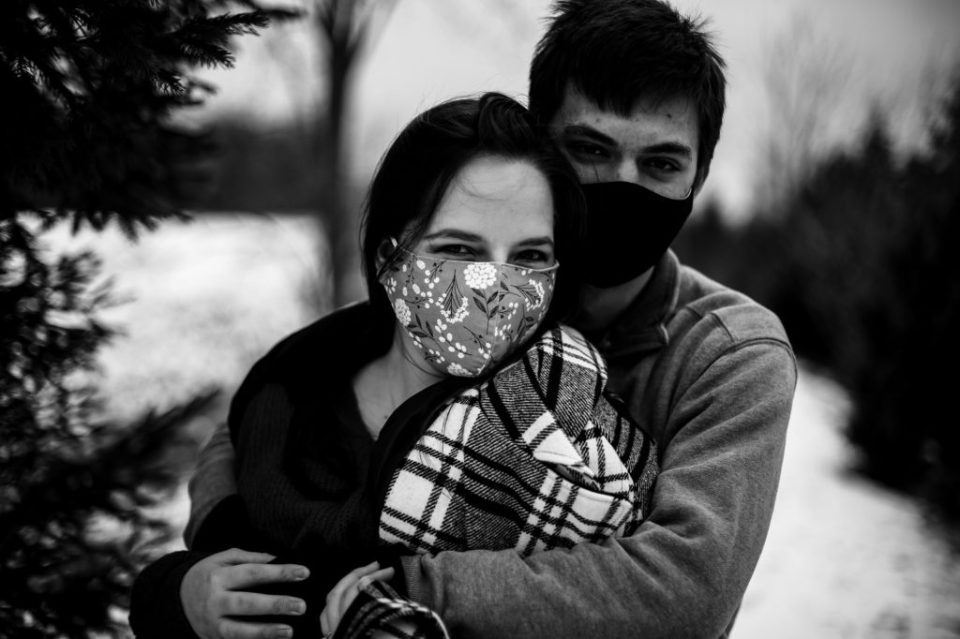 Couple wearing face masks for Penn State Erie engagement photos