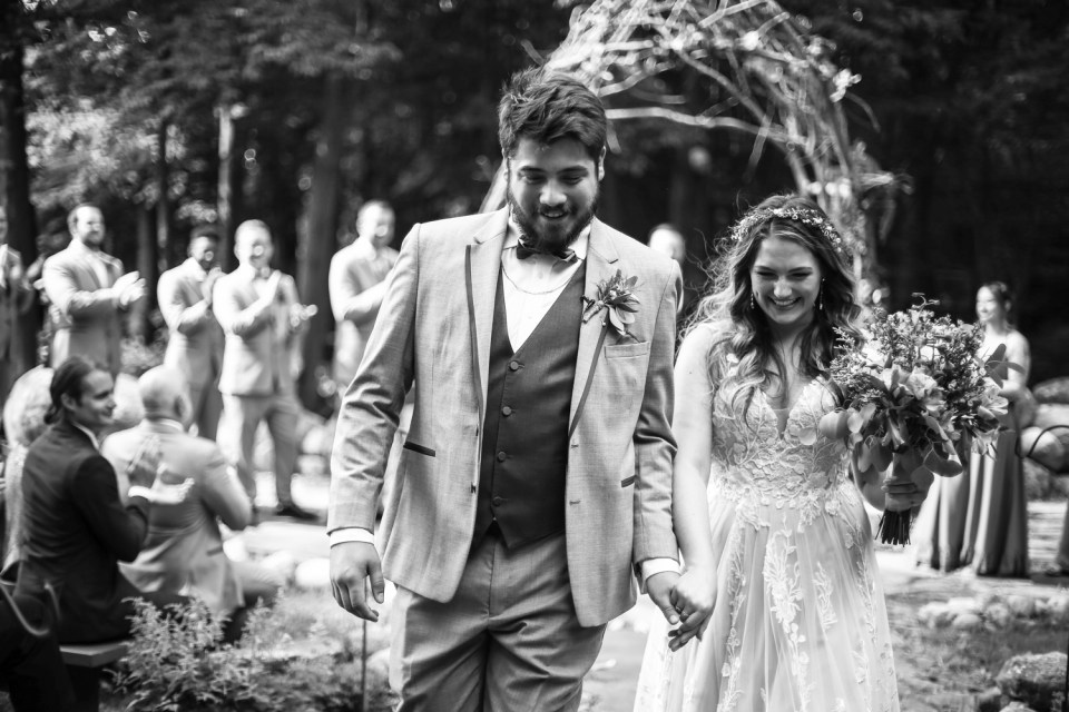 Recessional photo of couple at Whispering Trees Manor wedding