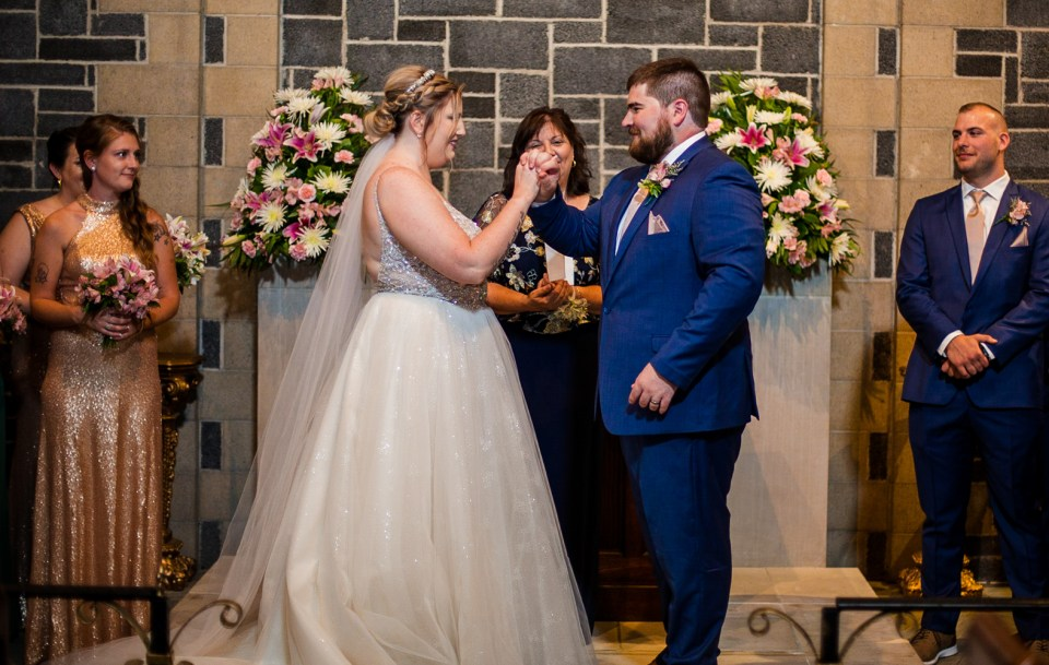 Couple exchanging vows in the chapel at Beach Glass Estates