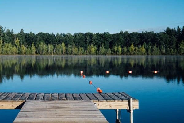 Dock overlooking a lake in Mattoon, Illinois on a sunny day.