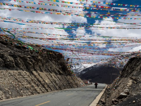 Prayer flags covering the mountain pass
