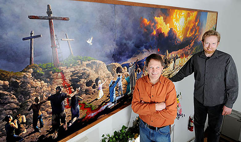 Dave Mattison, and Matt Philleo, members of Bethel Church, stand in front of new mural depicting the Gospel from Genesis to Revelation. Photo taken March 27, 2013 by Leader Telegram photographer, Dan Reiland