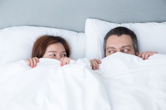 Heavy people on bed