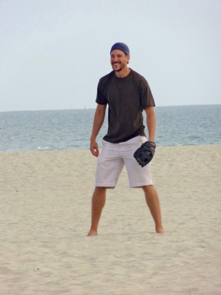 Matt playing catch on beach